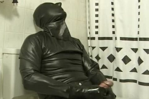 lad In dark Latex Catsuit Jacks Off In baths