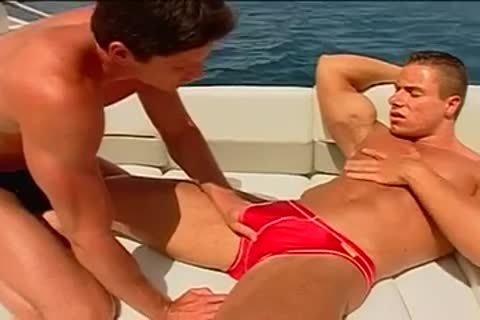 Fervent arse pumping on the yacht with muscled males