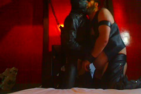 Two Leathermen engulfing Session