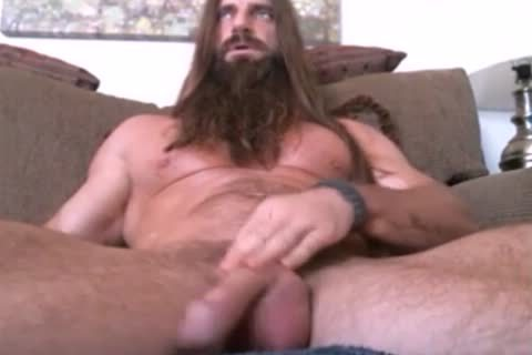 lengthy Haired And Bearded Muscle lad Solo