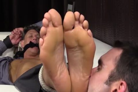 Bryce Evans Is fastened Up And Has His Toes Licked On The daybed