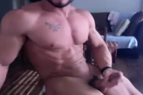 Muscle twink gets nude And Wanks On web camera