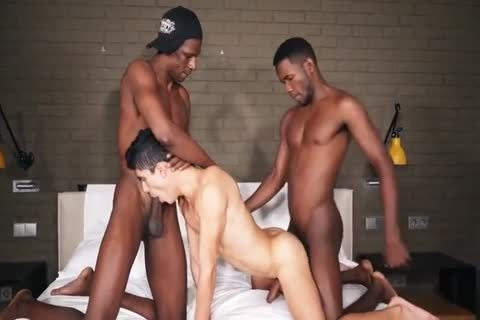 A favourable naughty twinks receives Two Large Dicked Hunky dark guys Who poke Him