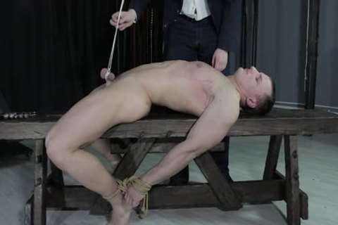 slutty dude fastened Down, Balls Strung Up And Spanked