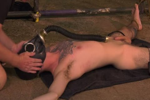 Roped Down twink receives A Gas Mask And A coarse handjob