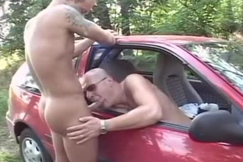Two excited males dril In The Woods In The Back Of His Car