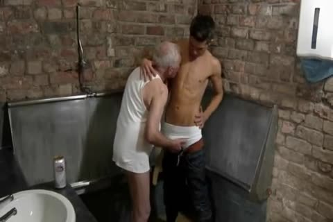 good Looking old man & young guy engulf Each Other In A Public