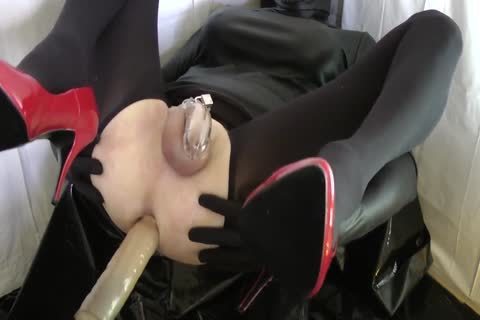Sissy With Red Heels Is banged In A Chastity Belt