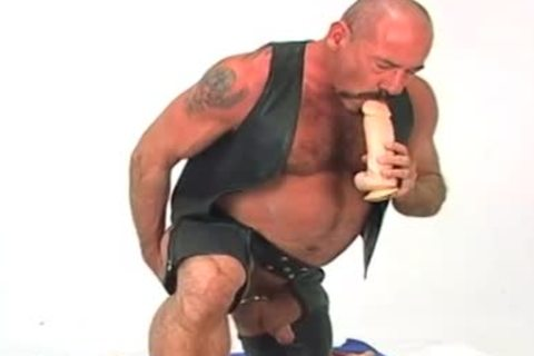 Butch leather wearing daddy chap w/ large dildo